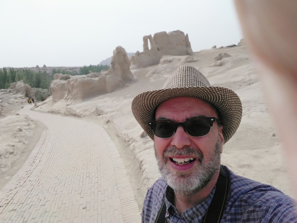 I'm in Jiaohe, a better preserved ancient city of ruins. Traveling alone, but with a few more tourists around.