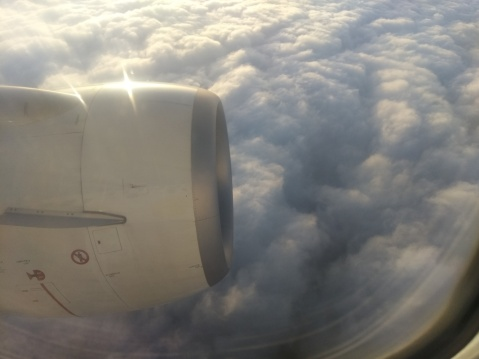 """The obligatory """"out of the airplane window"""" shot of thick clouds over Urumqi on the way home."""